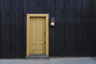 Brown door in dark wall