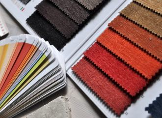 Fan deck paint chart along side material samples