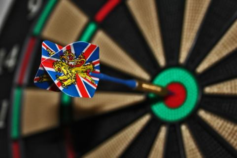 one dart stuck into the bulls eye of a dartboard