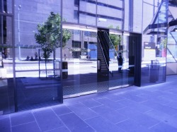 Glass entry doors to commercial building